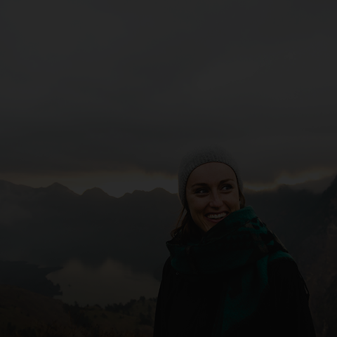 gray overlay of woman hiking mountain