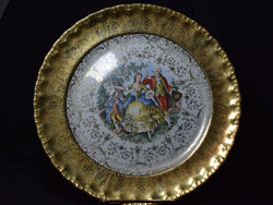 porcelain plate is marked Made in USA - Warranted 22 Karat Gold