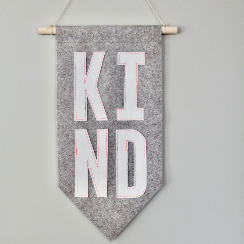 KIND banner with neon pink stitching by Joy.nd