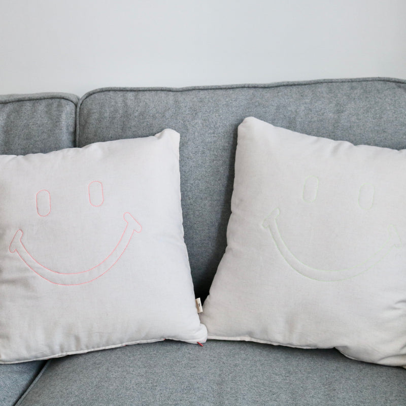 Smily face hand quilted pink neon cushion by Joy.nd