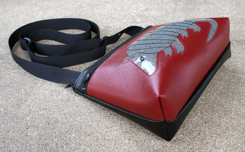 Silver glitter armadillo on burgundy crossbody purse