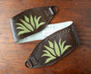 Green agave on brown vinyl belt