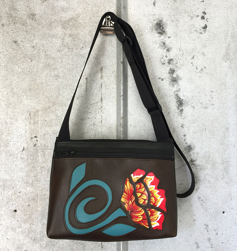 Red floral on brown vinyl small crossbody