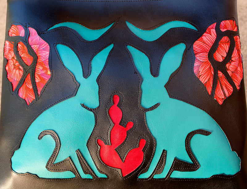 Turquoise jackrabbits and flowers on black vinyl