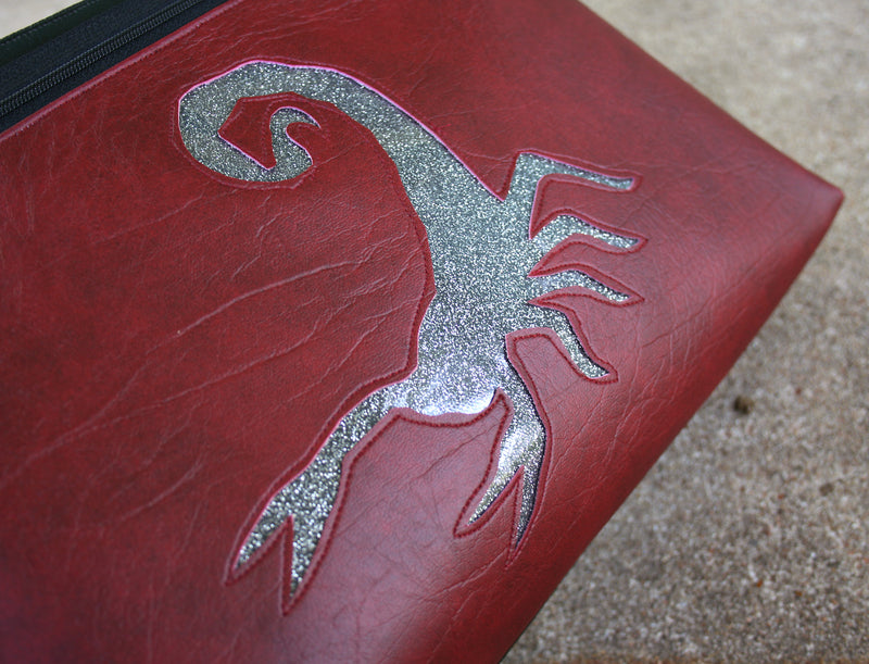 Silver glitter scorpion on dark red vinyl