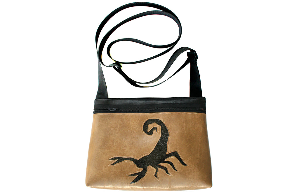 Black glitter vinyl scorpion on distressed tan crossbody purse