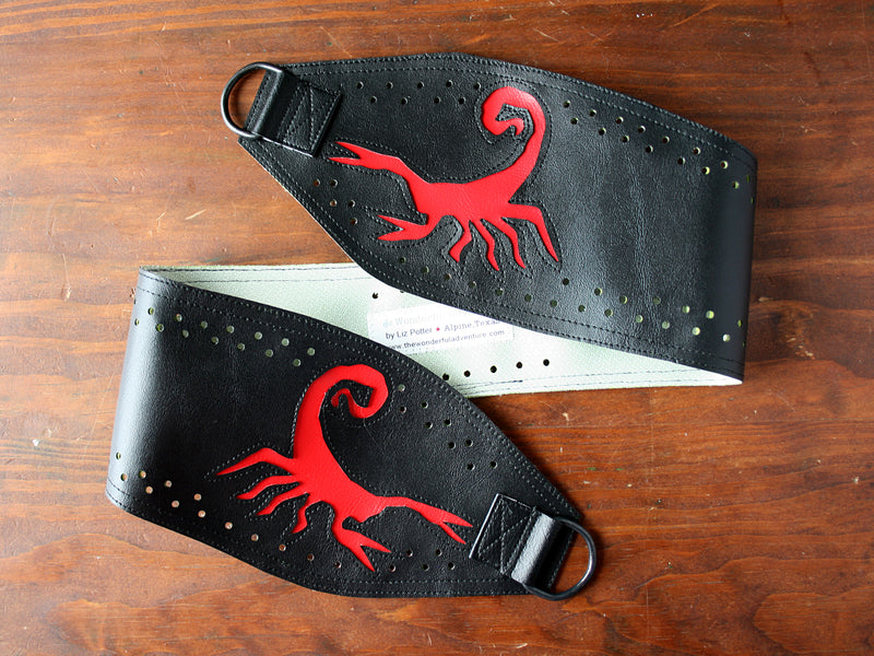 Scorpion red on black vinyl belt