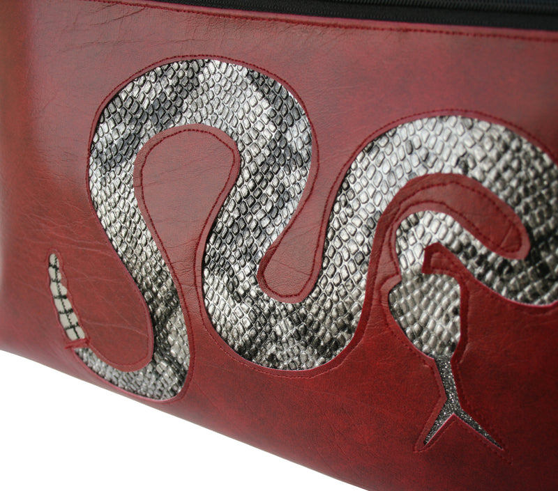 Silver rattlesnake on dark red vinyl