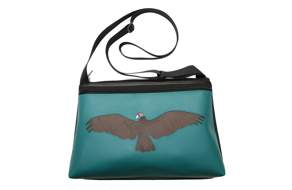 turquoise colored vegan leather purse with vulture applique