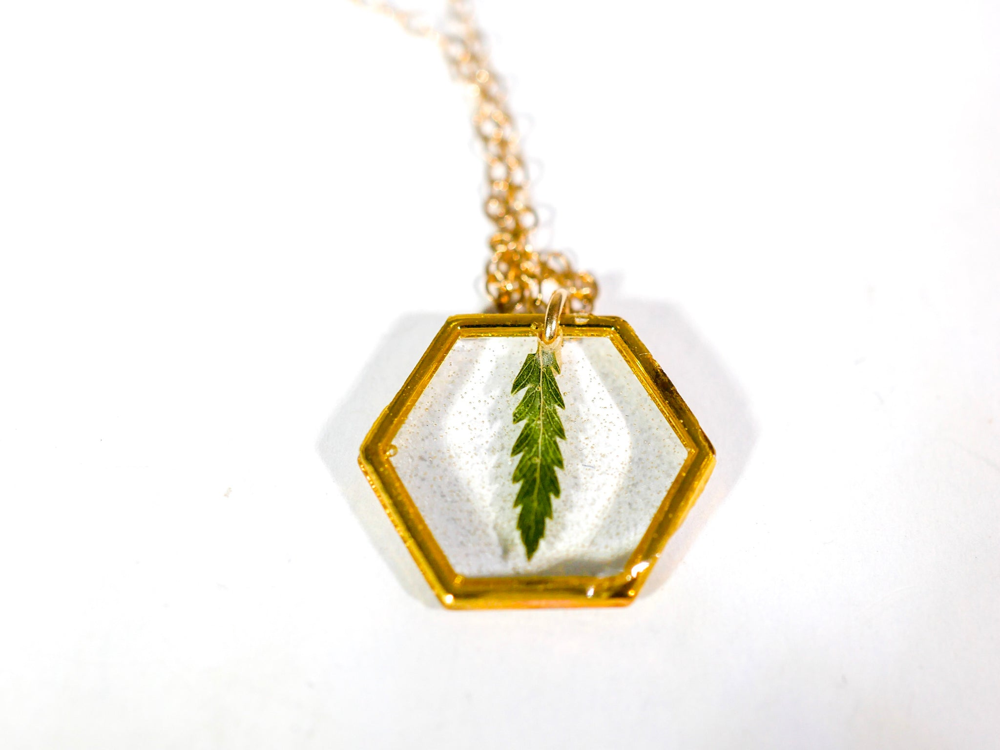 Tiny gold hexagon fern