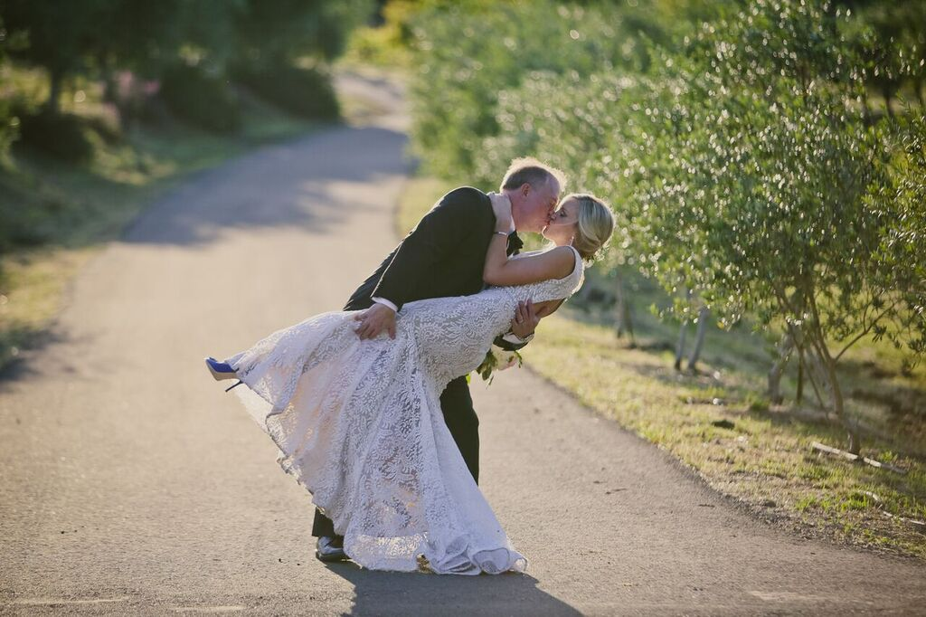 napa valley weddings couple groom dippigng bride