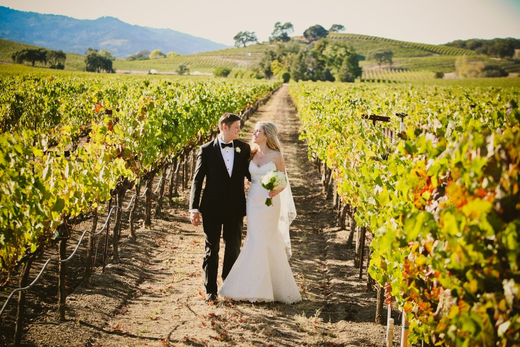napa valley vineyard wedding couple with flowers