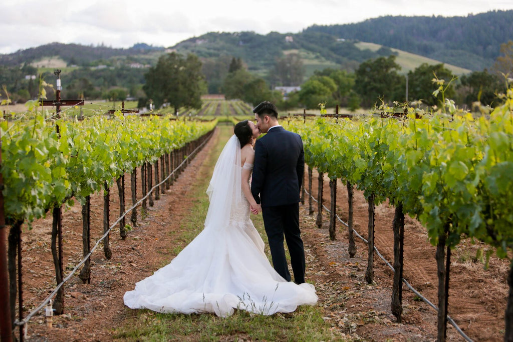 outdoor wedding couple napa valley vineyard