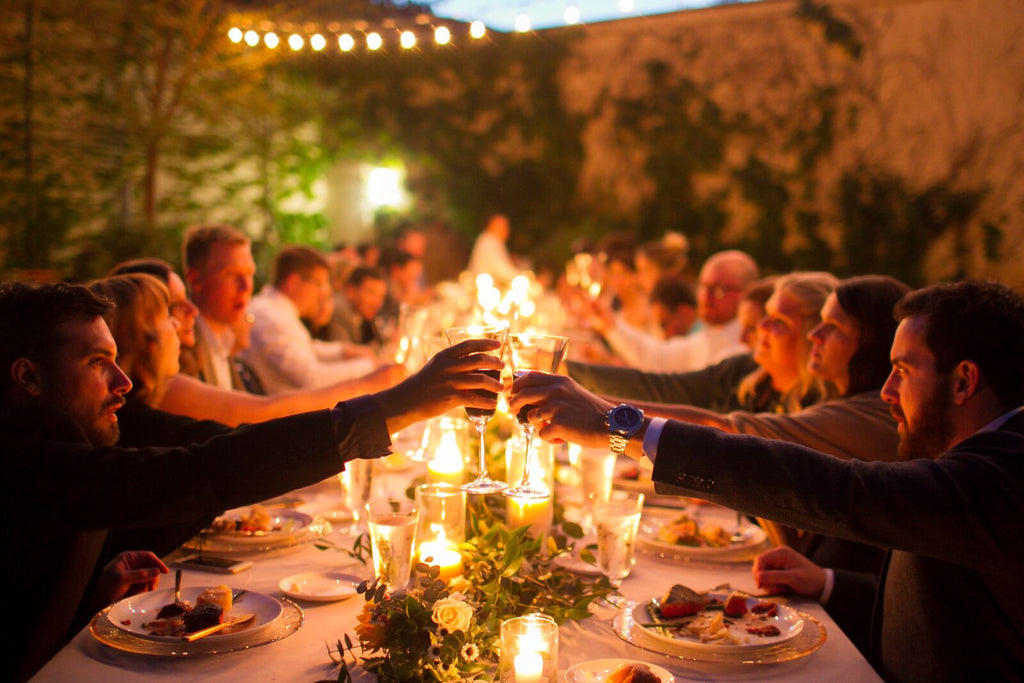outdoor nighttime wedding reception dinner