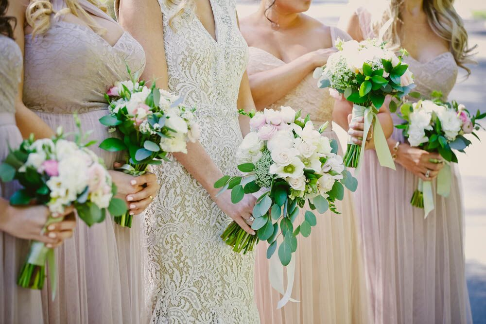 vintage wedding dresses on bridesmaids with flowers