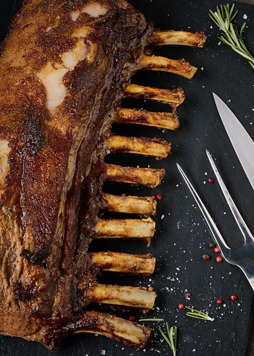 Image of golden cooked 10 bone Frenched whole Rack - Heritage