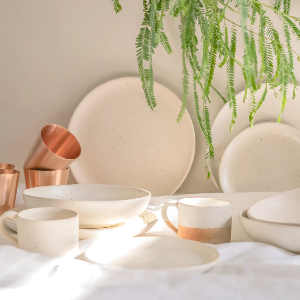 Shop speckled white ceramic mugs, cups, plates, bowls & other dinnerware