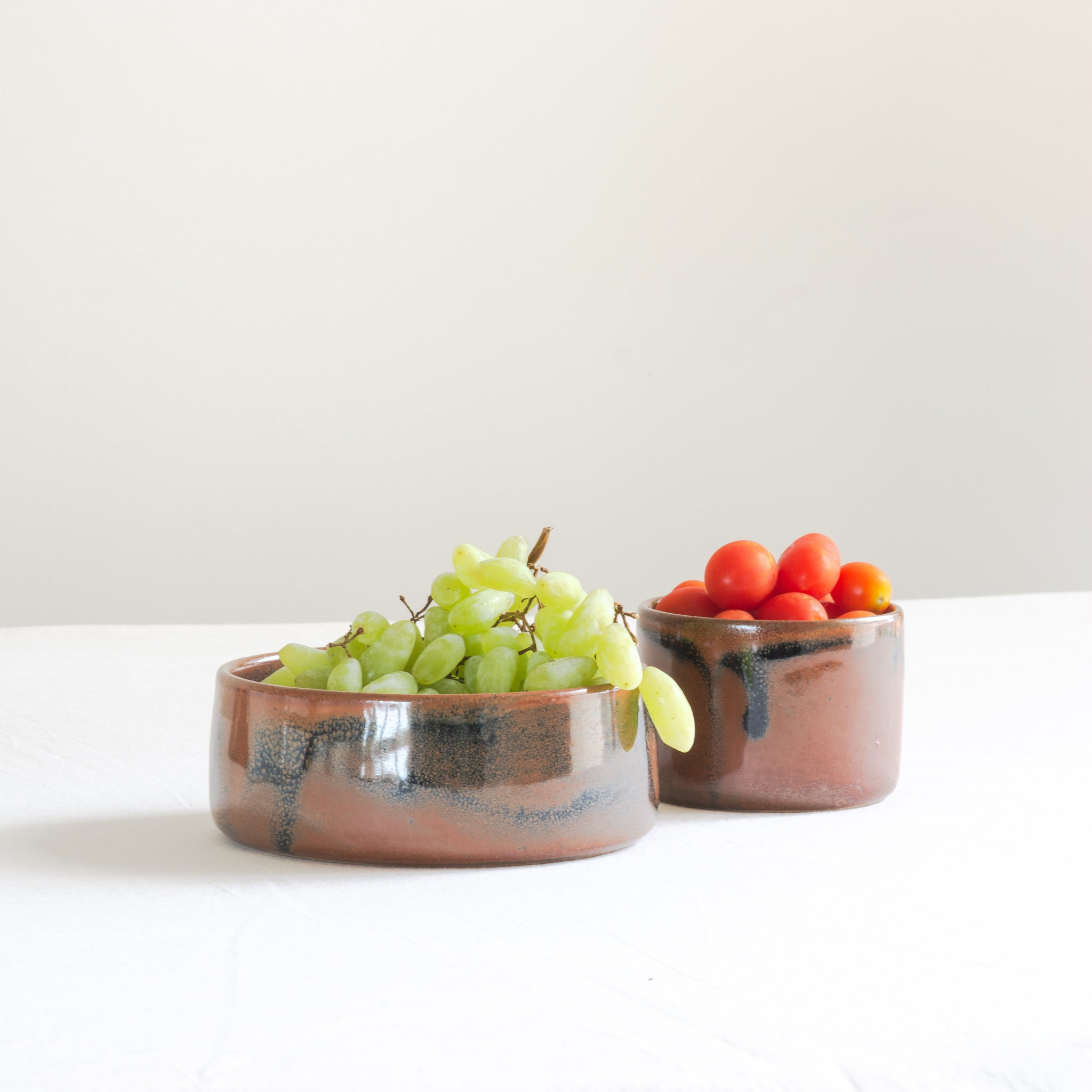 Handmade studio pottery cognac ceramic bowls with fruits in it