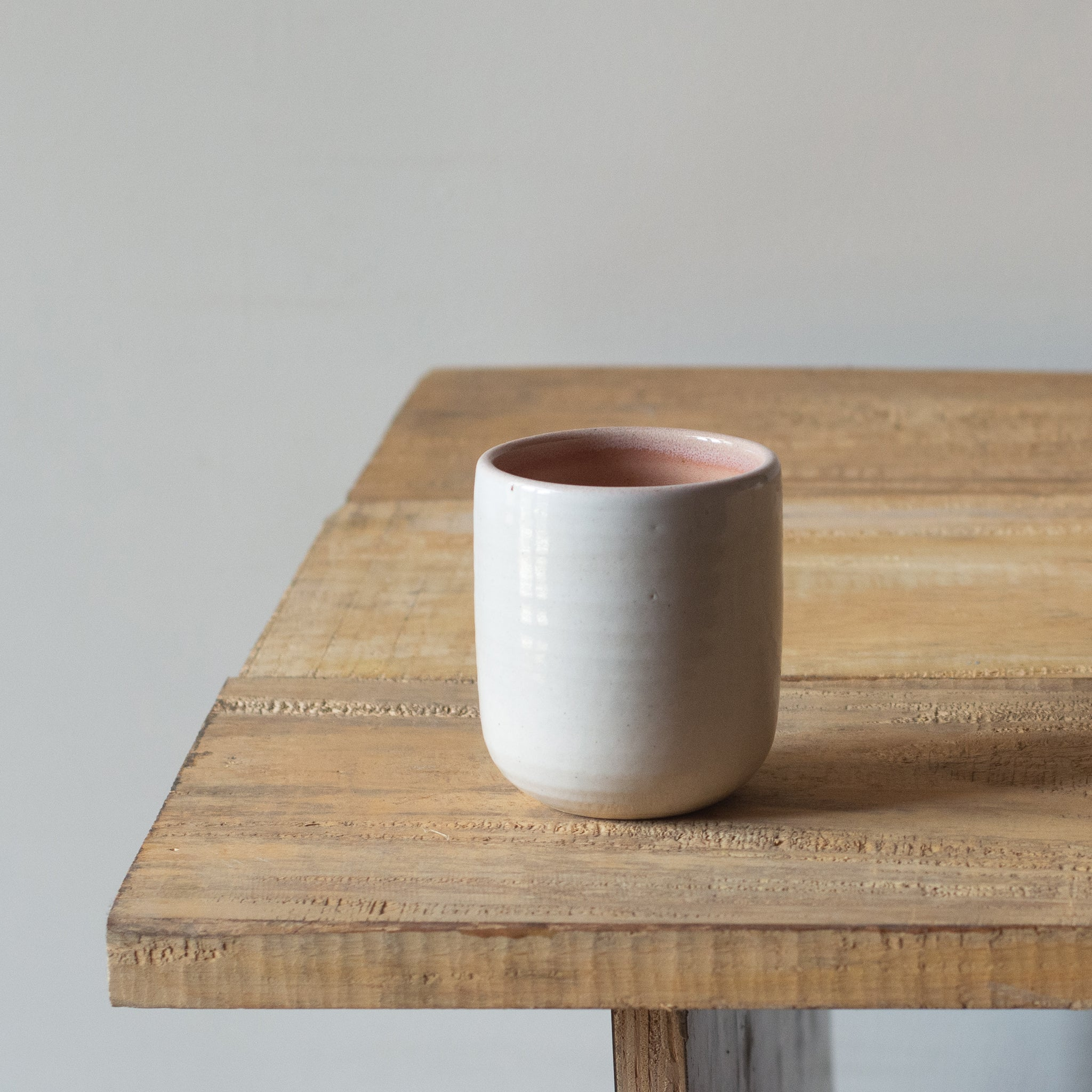 Peach tumbler on a table. Part of geode collection by fleck