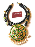 Two layer black beads with green kemp stones Neckpiece