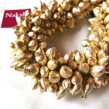 Gold mallipoo hair accessory