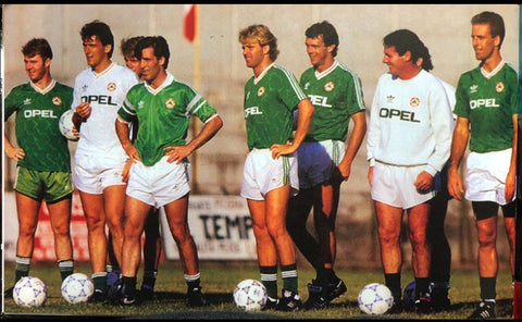 An early 90's Irish squad train in their home and away shirts.