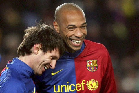 Young Lionel Messi shares a laugh with French superstar Thierry Henry.