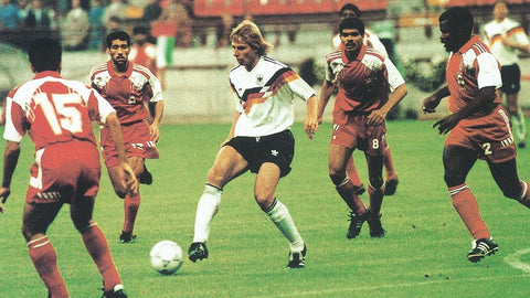 Jürgen Klinsmann takes on multiple defenders from the United Arab Emirates.