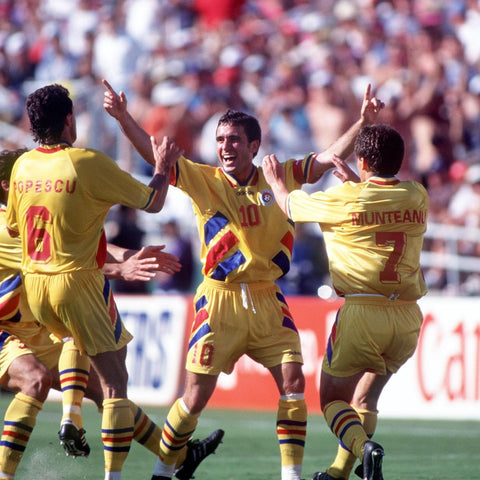 Gheorghe Hagi embraces his teammates after scoring a screamer against Colombia.