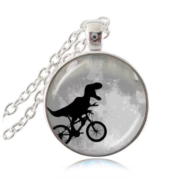 Dinosaur riding a bike necklace