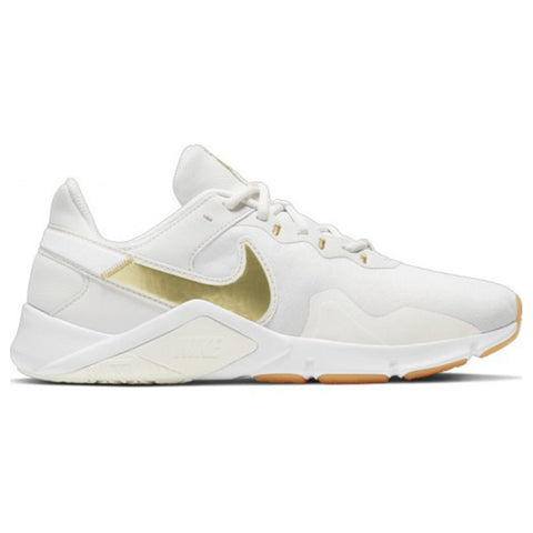 NIKE WOMEN'S LEGEND ESSENTIAL 2 TRAINING SHOE PLATINUM TINT/METALLIC GOLD STAR