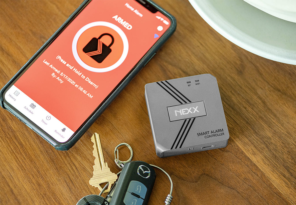 Nexx Smart Alarm NXAL-100 WiFi Nexx Home App Armed Press and Hold to Disarm car keys coffee