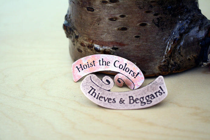 Hoist the Colors / Thieves and Beggars Pin Set