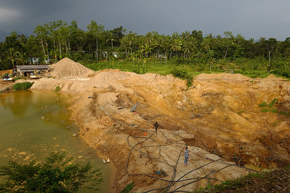 This is a typical scene showing larger-scale, mechanized gemstone mining in Ratnapura