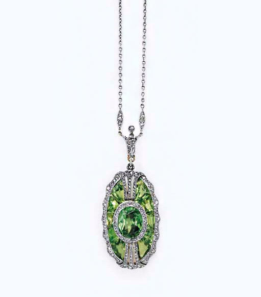 A Belle Epoque demantoid garnet and diamond pendant. Property from the estate of Frances Leventrit. Sold at Christie's New York in December 2005. Clasp signed Tiffany & Co