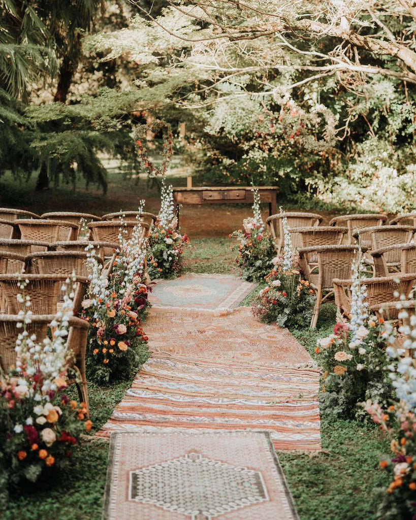 mismatched rug wedding aisle