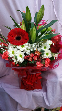Festive aqua box bouquet . Capture the seasonal cheer with this christmas arrangement . Consisting of oriental lilly , red rose ,carnation spray , seasonal chrysanthamum ,gypsophilia , large gerbra , shamrock bloom chrsanthamum , seasonal foilage , with christmas baubel and pick .