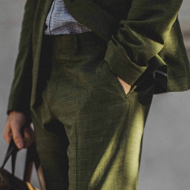 Our fit model in the green trousers