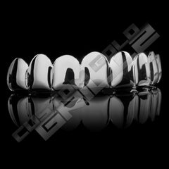 Get that million dollar smile for cheap with our Silver Joker Grill Fake Costume Teeth Top. Hurry before we sell out!