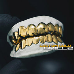 Solid Gold Deep Cut Custom-Made Grillz including Logo on Creative Background