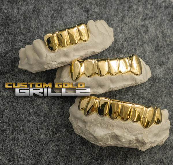 Solid Gold Custom-Made Grillz Bottom including Logo on Creative Background