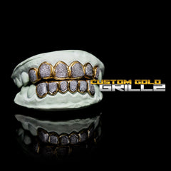 Solid Gold Two Tone Diamond Dust Custom-Made Grillz including Logo on Black Background