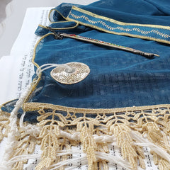 Folded Atlantic blue tallit with gold lace trim