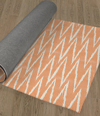 WAVE RIDE ORANGE Area Rug By Becky Bailey