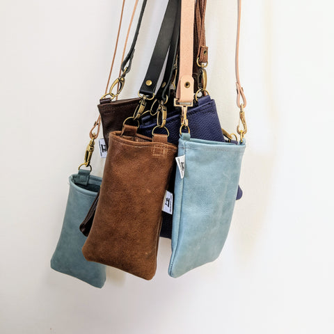 group of leather phone pouches