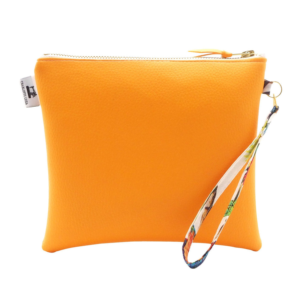 Tangerine Orange Clutch Bag in Faux Leather with Water Resistant Lining and Wrist Strap