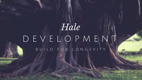 Humungous tree trunk with root system. Word overlay reads: Hale Development - Build for Longevity.