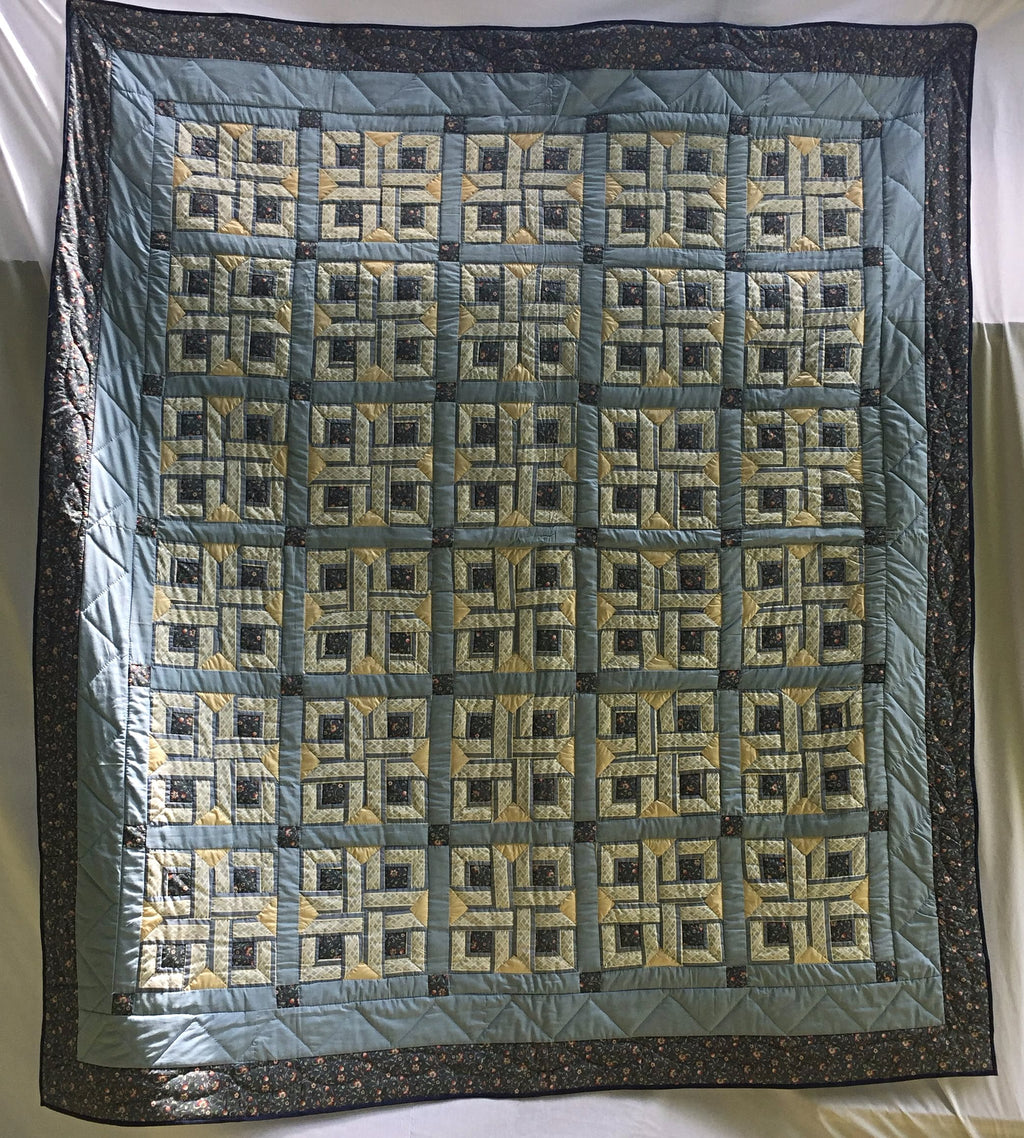 "Handpieced, handquilted brand new heirloom quilt in baby blue, dark blue and yellow basketweave ""Love Knot"" Pattern. 92"" x 104""."