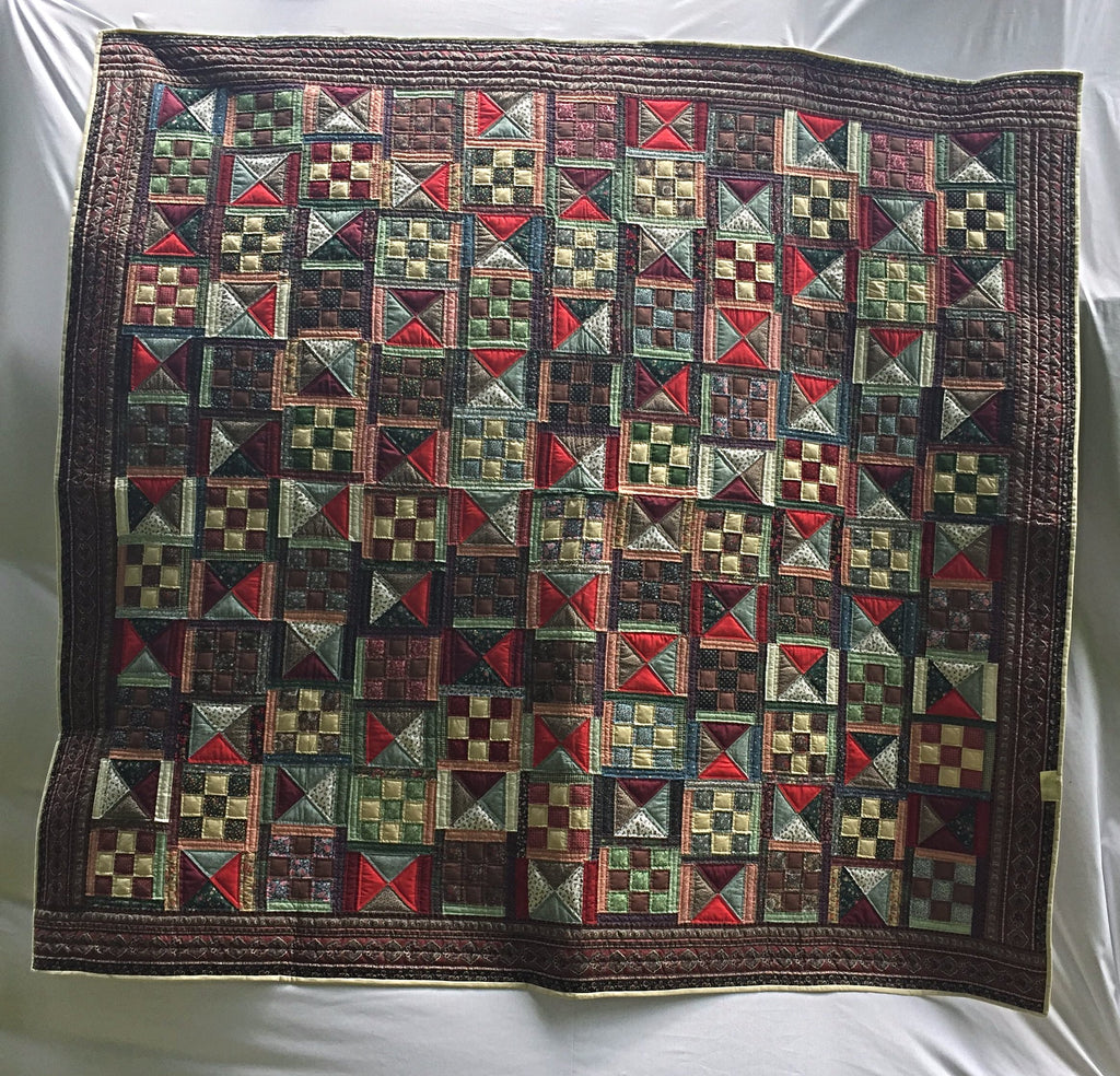 "Multi-colored hand-pieced, hand-quilted brand new heirloom quality quilt with bright red triangles in the Nine Patch and Hourglass Patterns. 92"" x 98""."
