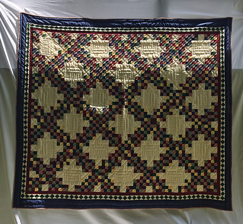 "Pretty primary colored squares dance around hand-quilted schoolhouses in the blank squares. Intricately hand-pieced and handmade by artisans in Kentucky, USA. 90"" x 99""."